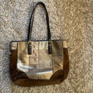 Coach brown, gold and bronze hand bag